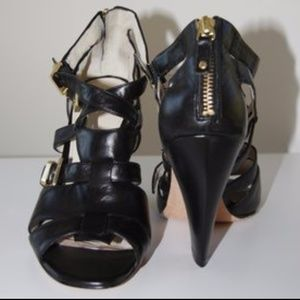 Black high heel strappy shoes, back zip
